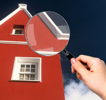 magnifying glass checking house