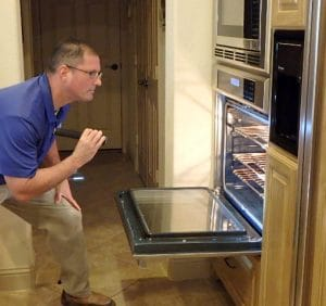 home inspector checking oven